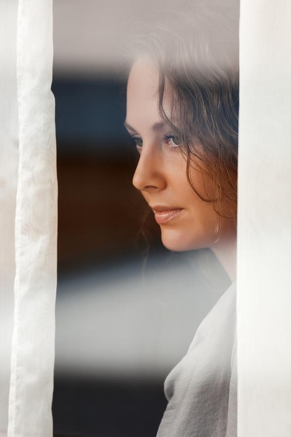bigstock-Sad-beautiful-woman-looking-th-34316297