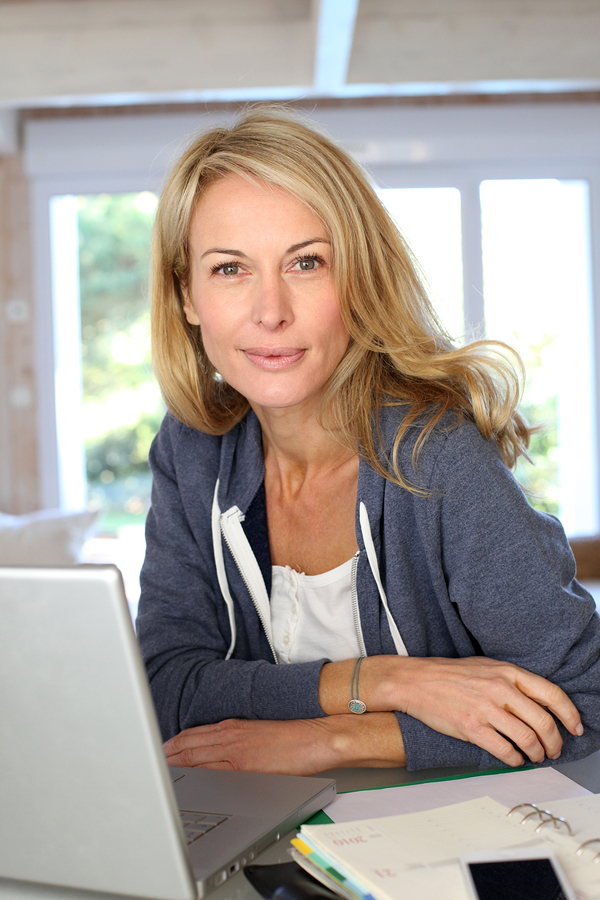 bigstock-Middle-aged-blond-woman-workin-33810623
